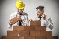 Businessmen building a wall Royalty Free Stock Photo