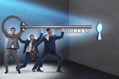 The businessmen in business success concept with key. Businessmen in business success concept with key Stock Photography