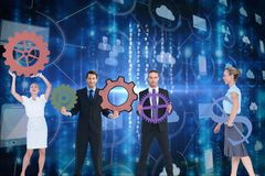 Businessmen and business women are holding sprocket against graphics background royalty free illustration