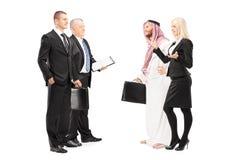 Businessmen and businesswoman having a conversation stock photos