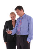 Businessmen and businesswoman look in phone Stock Photo