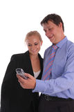 Businessmen and businesswoman look in phone Royalty Free Stock Photo