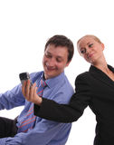 Businessmen and businesswoman look in phone Stock Image