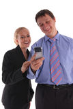 Businessmen and businesswoman look in a phone Royalty Free Stock Photography