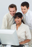 Businessmen and businesswoman working im an office Royalty Free Stock Photo