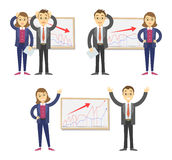 Businessmen and businesswomen on the background of the graph. Royalty Free Stock Photo