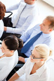 Businessmen and businesswomen on conference Stock Photography