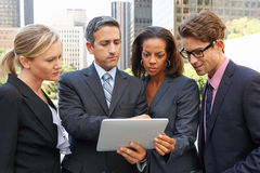 Businessmen And Businesswomen Using Digital Tablet Outside Royalty Free Stock Photo