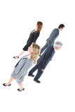 Businessmen and businesswomen walking Royalty Free Stock Photo