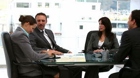 Businessmen and businesswomen working together stock footage