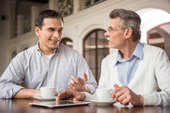 Businessmen in cafe Royalty Free Stock Image