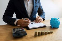 Businessmen calculate the cost each day to keep the money .finance concept . stock images