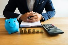 Businessmen calculate the cost each day to keep the money .finan. Ce concept royalty free stock image