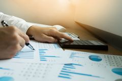 Businessmen calculate earnigs business performance, business con stock photo
