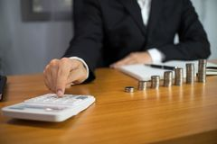 Businessmen calculate earnigs business performance, business concept royalty free stock images
