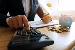 Businessmen calculate investment expansion business, saving money .finance concept . royalty free stock images
