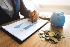 Businessmen calculate investment expansion business, saving money .finance concept . stock images