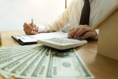 Businessmen calculate investment expansion business, saving money .finance concept . royalty free stock photos