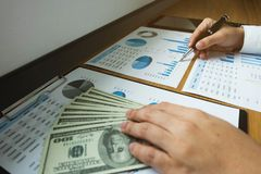 Businessmen calculate investment expansion business, saving money .finance concept . royalty free stock photography