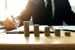 Businessmen calculate investment expansion business, saving money .finance concept . royalty free stock photo