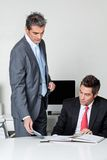 Businessmen calculating finances Stock Images