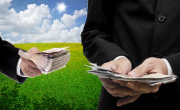 Businessmen carry money with nice landscape background Stock Images