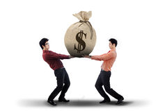 Businessmen carrying a money bag Stock Photos