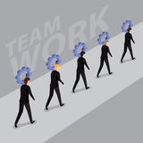 Businessmen carrying a sprocket in a row. Teamwork, success and team work Royalty Free Stock Photo