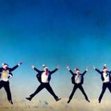 Businessmen Celebrating Christmas on Snow Mountain Concept Stock Image