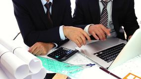 Businessmen checking the deal stock footage