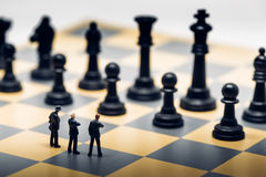 Businessmen on a chessboard. Business strategy concept.  Royalty Free Stock Image