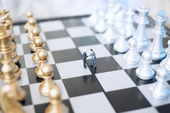 Businessmen on chessboard. Two  toy businessmen, lawyers or politicians on a chessboard. Agreement concept Stock Images