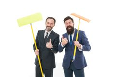 Businessmen clear wall to white. clean slate. cleaning company. clean business. mature bearded men in formal suit hold. Householding mop. Partnership and royalty free stock images