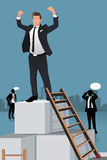 Businessmen Climbing to the Top of Box Stock Image
