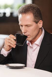 Businessmen at coffee break. Thoughtful mature men in formalwear. Businessmen at coffee break. Thoughtful mature man in formalwear drinking coffee at restaurant Royalty Free Stock Image