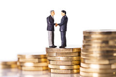 Businessmen on coins Stock Images