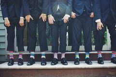 Businessmen with colorful socks