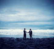 Businessmen Commitment Handshake Beach Relaxatiion Concept Stock Images