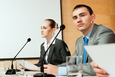 Businessmen communicate at the conference Stock Image