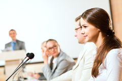 Businessmen communicate at the conference Stock Photos