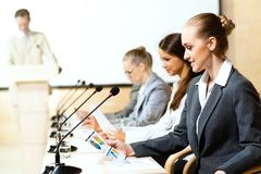 Businessmen communicate at the conference Royalty Free Stock Image