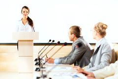 Businessmen communicate at the conference Stock Photo