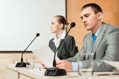 Businessmen communicate at the conference Stock Images