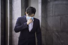 Free Businessmen, Company Employees Wear Protective Masks To Prevent PM 2.5 Dust And Virus COVID-19. Businessman Air Excessively Smelli Royalty Free Stock Photos - 176442498