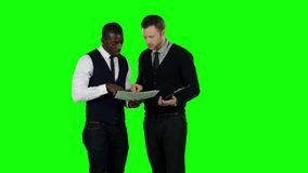 Businessmen consider the documents. Green screen. Businessman considering documentation, two businessman dressed in formal wear, working moments, green screen stock video