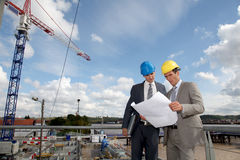 Businessmen on construction site Stock Photography