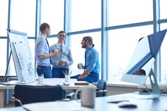 Businessmen consulting Stock Images