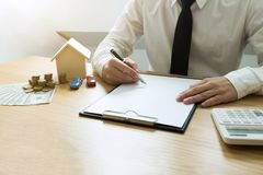 Businessmen contract on trading - rent a house. Businessmen insurance home. Business concept.  stock images