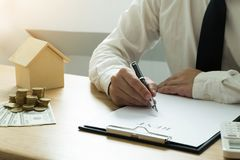 Businessmen contract on trading - rent a house. Businessmen insurance home. Business concept.  royalty free stock image