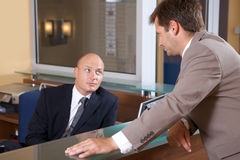Businessmen conversing at office Stock Photos